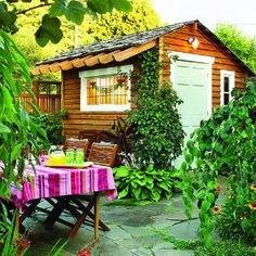 A shed in the right spot can help define an outdoor dining area or patio.