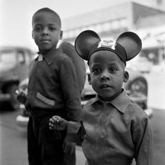 The godmother of street photography, Vivian Maier. [The tot in the mouse ears reminds me of Jay-Z.]