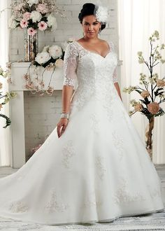This v neck line wedding gown has sheer lace sleeves.  The end at the elbow. But when our design firm is making #plussizeweddingdresses specific to our clients we can make any change to a design that is needed. In addition to affordable #weddinggowns that are made to order we also offer #replicas to brides on a budget. Get more info and pricing on any dress in a picture from us at www.dariuscordell.com