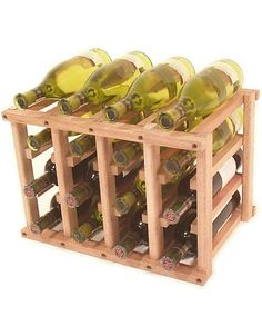 This 16 Bottle Wine Rack is made of wood, and stores 12 bottles inside and 4 more on top. The wine rack is available in pine, oak, and mahogany. Small Wine Racks, Wood Wine Racks, Wine In The Woods, Carbs In Beer, Wine Club Membership, Wine Tasting Notes, Wine Deals, Expensive Wine, Wine Bottle Holders
