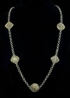"""Rhodium Coin Necklace  Rhodium and 18k gold plated necklace with coin and diamond shape design. Necklace length is 35"""""""" with lobster claw clasp.   http://www.sterlingjewelrystores.com/product648.html"""