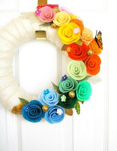 I love this... Want it for my front door! cream yarn wreath accent with beading & rainbow felt roses.