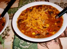 Turkey Chili -   Cooked shredded white meat turkey, 1 Can black beans,1 can kidney beans(both rinsed),  1 Jar medium salsa, 1 Can diced tomatoes with green chilies  1 Can sweet kernel corn (drained) 1 Small onion (Diced)  1 Red and 1 Green bell pepper (Diced) Add a small amount of chili and garlic powder Fresh ground black pepper, No salt Top with: low fat shredded cheddar cheese and fat free or low fat sour cream