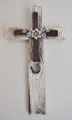 One of a kind rustic reclaimed white wood cross with rose and silver leaves great for cottage chic or western decor. $48.00, via Etsy.