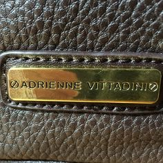 Adrienne Vittadini satchel purse Brown leather, red interior with middle zip interior 2 side compartments on each side.  Bag zips closed, very nice! Adrienne Vittadini Bags Satchels