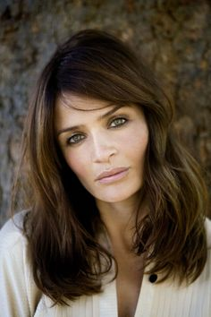 Helena Christensen. Shoulder length dark brown hair with highlights and natural messy waves