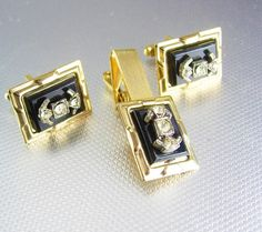 Vintage Rhinestone cufflinks tieclip set black insignia. This is an original set complete with the gold tone cufflinks and tie clip.. What