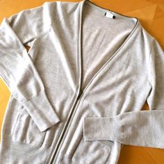 Jcrew grey cardigan with zipper detail Lovely cardigan in great condition. Functioning zipper closure and pockets. True to size. 100% merino wool. J. Crew Sweaters Cardigans