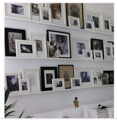 Photo wall with shelves