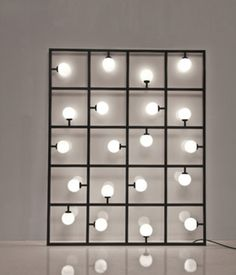 Atelier Areti's sculptural grid-likeSquares floor/wall lampis designed to lean against the wall, but can also be attached to the wall or suspended from the ceiling.