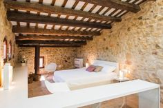 Located in the medieval town of Pals in Baix Empordà, Girona, Spain, this historic stone house built in 1889 has been restored and modernized by Gloria Duran Arquitecte. Triangle House, Basement Layout, Sweet Home Alabama, Wood Stone, Spanish House, Loft Spaces, Stone Houses, Cuisines Design, Villa