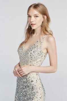 Draped in thousands of dazzling crystals is the only way to be crowned Prom Queen!  Sexy and sparkling, this floor length nude sheath dress is covered with a lustrous mix of beautiful crystal beading for a unique, over-the-top Prom look.  Illusion detail at the straps and sultry v-neckline add appeal and drama to finish off this gorgeous gown.  Designed by Night Studio.  Fully lined. Zipper Back. Imported.  Spot clean only by professional dry cleaner. Do not apply heat or steam
