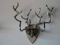 a story about art and bikes at the We HeART Bikes 2011 exhibit; this bicycle part deer mount was created by bike mechanic Casey Clark