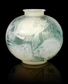 René Lalique 'Poissons' a Vase, design 1921 opalescent glass, heightened with blue staining 23cm high