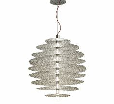 The Tresor Suspension Lamp is purely hand-made. It has a flawless design with optimum functionality. It also features a long cylindrical bar that carries a stack of circular disks. The entire structure of the Tresor Suspension light is gleamed using nine G9 halogen bulbs, thus flaunting its exquisite finishes in silver and gold. http://www.olighting.com/terzani-tresor-suspension-light.html