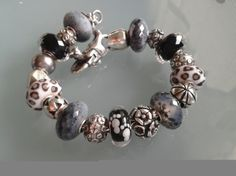 A collector from Germany has incredible beads and it's always fun to see how she puts them together.  See this and many other ideas on Trollbeads Gallery Forum.