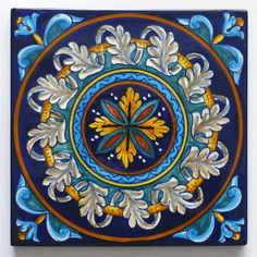 "<h3>This hand painted tile is part of the Geometric Collection created by Eugenio Ricciarelli, one of the most renowned ceramic painters in Deruta. His unmistakable, velvety blue is the common background of six original patterns, all painted in rich, warm hues.</h3><br /> <p><a href=""http://www.thatsarte.com/contacts"">Contact us</a> with your ideas and projects: special orders are welcome. </p>"