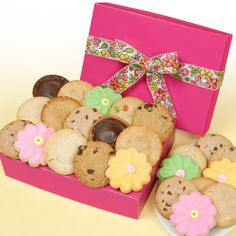 Pretty Pink Box of 24 Cookies $54.99  Freshly baked assortment Includes: 6 Buttercream Frosted Flower Cutouts  2 each of the following assorted gourmet cookies: Chocolate Frosted Peanut Butter, Chocolate Frosted Brownie, Chocolate Chip,Oatmeal Raisin, Sugar,Peanut Butter,Snickerdoodle, M and M.,White Chocolate Chip, and Chocolate Chip Pecan