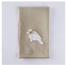 "Linen towel with blanket stitch trim features hand knotted French knot bird with Jute bow and printed ""Chirp"" tag."