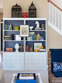 An oversized bookshelf -- made from two separate units -- provided a space to showcase keepsakes and vintage books. A deep blue backdrop added depth and created one-of-a-kind character.