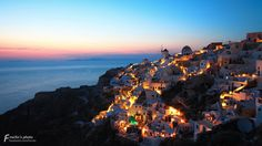 One of the famous sunset point in the World, Oia, Santorini.  Romantic sunset of the Aegean Sea, Greece