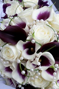 Dramatic deep calla lilies softened with pearls in this hand-tied bridal bouquet