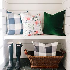 Salt Lake City–based Studio McGee designed the pillow in flowery bright colors. Pair it with giant buffalo checks or a deep emerald velvet for a nice layered look.