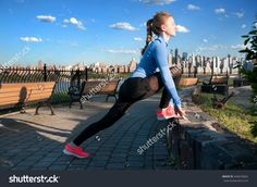 Sport and fitness. Woman stretching before run in park with view of downtown Manhattan New York city.