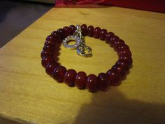 "New Listing Started Charmology glass bead stretch bangle 8.5""long in top condition with two charms £2.50"