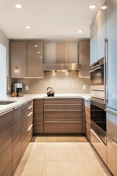 "Great ideas in this Contemporary Kitchen by Lee Kimball --The U-shaped kitchen is by Poggenpohl and includes an induction cooktop. ""We crammed a lot of great storage into the kitchen,"" Johnson says. This includes drawers under the cooktop and efficient corner cabinet storage. Lighting includes square LEDs that are flush with the bottom of the cabinets. --Pinned by WhatnotGems.Etsy.com"