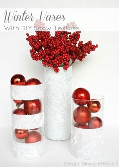 DIY Christmas Centerpiece | Create a cheap yet chic Christmas or winter centerpiece with glass cylinders from the dollar store! Change the filler and completely change the look!