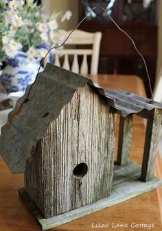 corrugated tin roof with old wood  (Take care - birds or fledglings may cook under a metal roof when the weather's hot!)