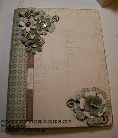 An altered composition book using Avonlea and Art Philosophy Cricut cartridge flowers