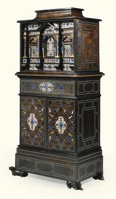 An Italian gilt-bronze and pietre dure mounted and ivory inlaid ebony cabinet on cabinet late 19th century