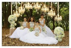 beautiful ceremony backdrop with cascading chandeliers and elegant floral arrangements