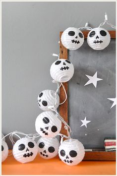 Looking a some last minute spooky Halloween decoration ideas? Check out these DIY paper lantern skulls from Julep.