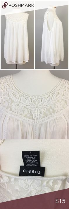 Torrid White Lace Flowy Sleeveless Blouse Torrid White Lace Flowy Sleeveless Blouse. Size 2X. Gorgeous blouse! Thank you for looking at my listing. Please feel free to comment with any questions (no trades/modeling).  •Fabric: Cotton blend!  •Condition: Very good, no visible flaws!   ✨Bundle and save!✨10% off 2 items, 20% off 3 items & 30% off 5+ items! ic torrid  Tops Tank Tops