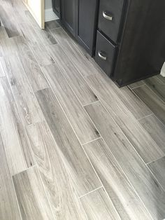 For the granny - Newly installed gray weathered wood plank tile flooring Plank Tile Flooring, Wood Plank Tile, Wood Tile Floors, Grey Flooring, Wood Planks, Bathroom Flooring, Kitchen Flooring, Flooring Ideas, Grey Kitchen Floor