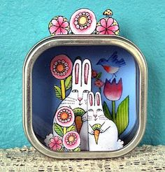 Using a tin box with a window, create a mini magical world. Use your own art printed on heavy paper, then cut out and glue in place