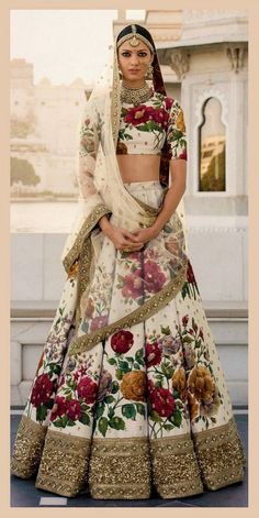 Get yourself dressed up with the latest lehenga designs online. Explore the collection that HappyShappy have. Select your favourite from the wide range of lehenga designs Sabyasachi Lehenga Bridal, Floral Lehenga, Indian Bridal Lehenga, Indian Bridal Wear, Indian Wedding Outfits, Indian Wear, Indian Outfits, Indian Saris, Sabhyasachi Lehenga