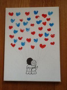 Als cadeau voor de bruiloft van meester gemaakt met de klas. Simpel, maar ontzettend leuk resultaat. Hartjes van vingerafdrukken van de kinderen en 'liefde is...' poppetjes.