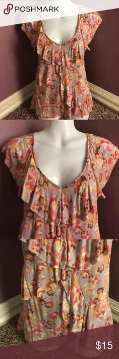 LC Lauren Conrad Knit Blouse Floral print Knit Blouse from LC Lauren Conrad. Grey/Purple background with colorful flowers all over. Ruffled a bit. Size XS. In good condition. LC Lauren Conrad Tops Blouses