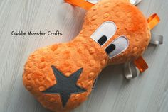 Cuddle Monsters are super soft sensory toys for babies, and make wonderful comforters for children of any age. Made from luxurious textured plush material, their monster bodies feel lovely, and are designed to be the perfect shape for squeezes with your own little monster. All of my monsters have ribbon hair do's, made from silky satin ribbons, which young children love to feel and play with. Playing with the ribbons also provides great comfort, and sensory stimulation that babies adore.