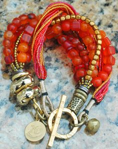 Custom Exotic Orange Glass, Bronze and Gold Multi-Strand Bracelet Contact me if you are interested in this bracelet
