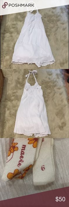 """Anthropologie Maeve Halter Dress AnthropologieWhite Cotton Gauze Lace Crocheted Trim Halter Dress  100% Cotton/Lined in 100% Cotton Side Zip Lace Waist and Bodice Trim Crocheted Trim on one Side of Halter Straps and Hem Approximate measurements: Bust 32"""" Waist 28"""" Length 42.5""""   Great Condition! Anthropologie Dresses"""