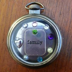 This pocket watch holds all of the birthstone colours of my immediate family.  I would be overjoyed to create a family pocket watch for you. Just tell me the dates of the birthdays and I will happily design one for you.  *Due to inventory, the family charm in the middle may not be precisely like the one shown. It will be matched as closely as possible.  I can also custom make a friend-themed pocket watch for you and your closest friend(s), or even husband and wife. If you have other ideas… The One Show, Are You The One, Create A Family, Birthstones, Pocket Watch, Custom Made, Watches, Accessories, Birthdays