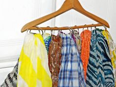 Folded scarves can get wrinkled in your dresser. To keep them at hand and looking fresh, attach shower curtain rings to a basic hanger, and loop your scarves through each ring.