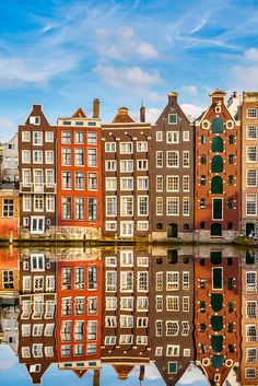Amsterdam, reflections of houses on the water.