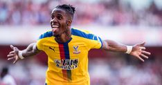 The future of Wilfried Zaha is once again a hot topic for Crystal Palace fans this summer, amid interest from Arsenal. The Ivory Coast international made it Crystal Palace Football, Ian Wright, Champions League Football, Arsenal News, Soccer Stadium, Free Football, British Sports, Transfer Window, Transfer News