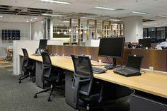 FinancePlus   Open plan workspace / echopanel / pink orange / teak workstation